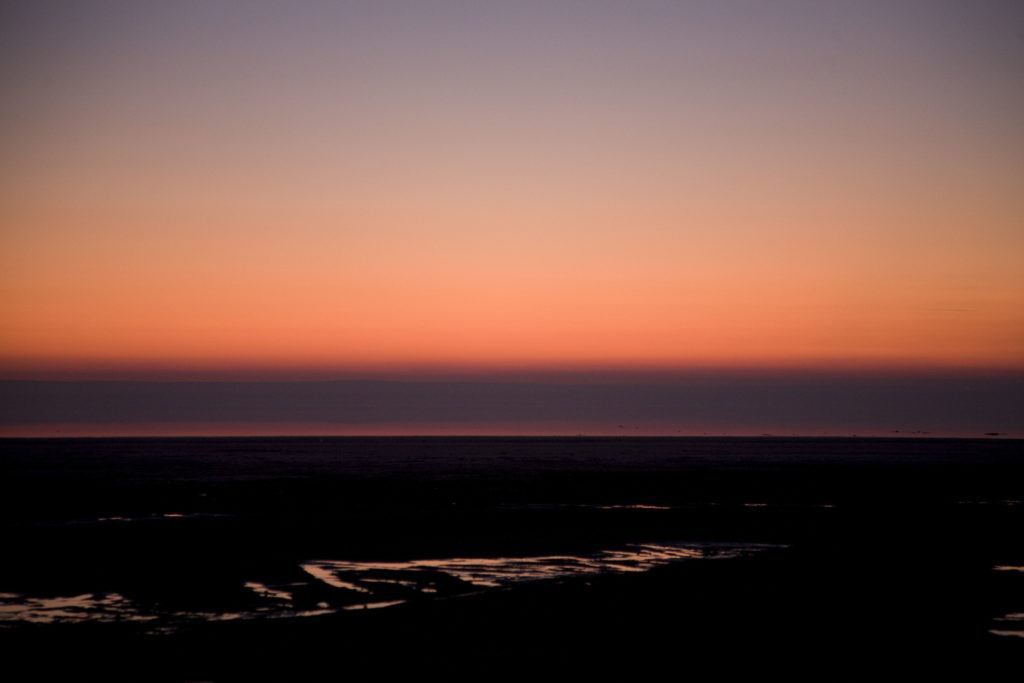 The sky turns red as the sun sets on Tuz Golu, a huge salt lake in central Turkey on your drive to Cappadocia from the north.