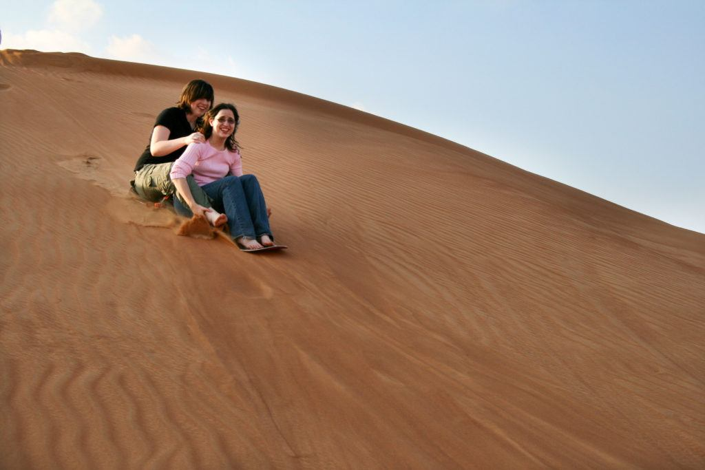 Sandboarding is one of the many adventure acitivities to try in Dubai.