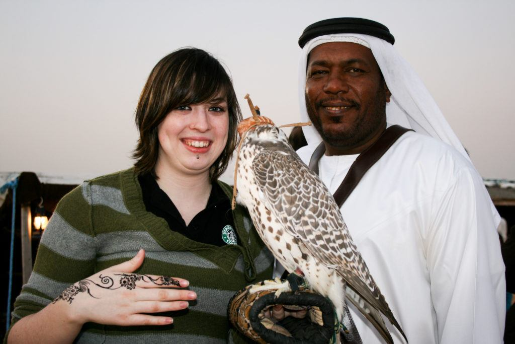 On a long layover in Dubai, Erika gets to hold a falcon.