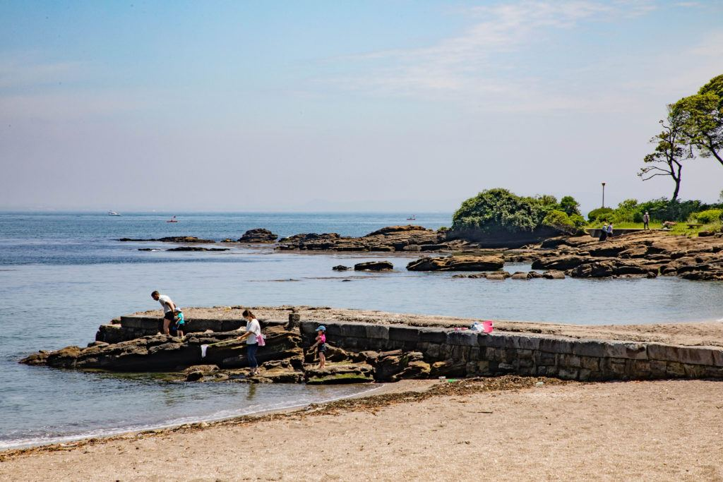 Families enjoy tide-pooling during the summer, like here at Kannonzaki Park in Yokosuka.