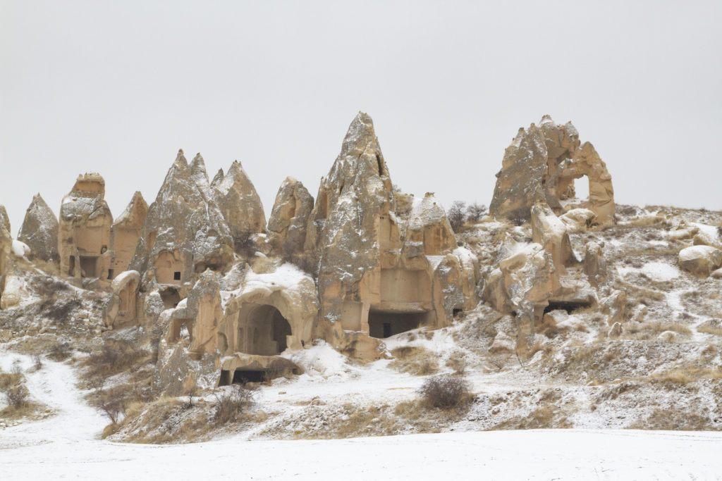 Snow blankets the fairy chimneys in Cappadocia.
