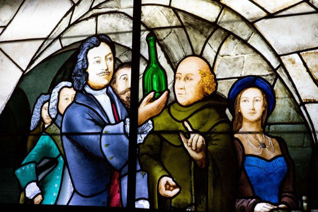 A stained glass window depicting the product of Champagne.