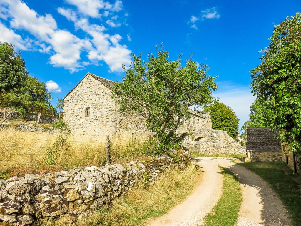 Stone house and dirt road in the Causses and Cevennes, France.