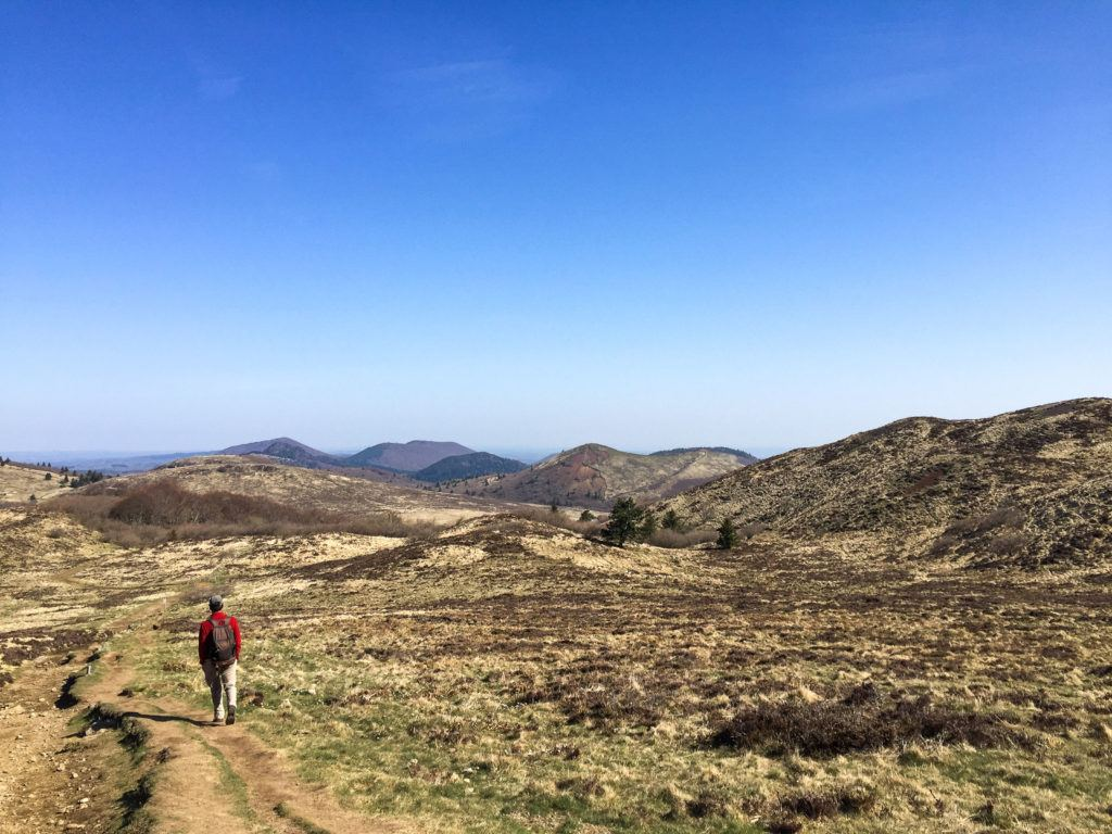 A man hikes the world heritage Chaine des Puys.