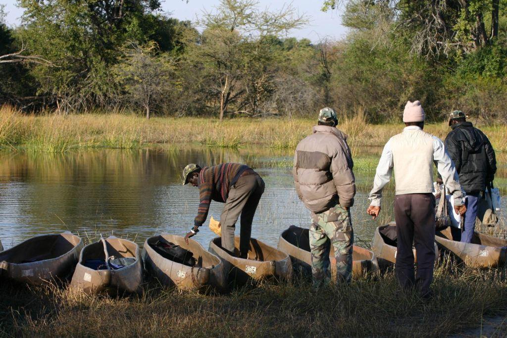Guides prepare the traditional dugout-like boats, for our Mokoro safari.