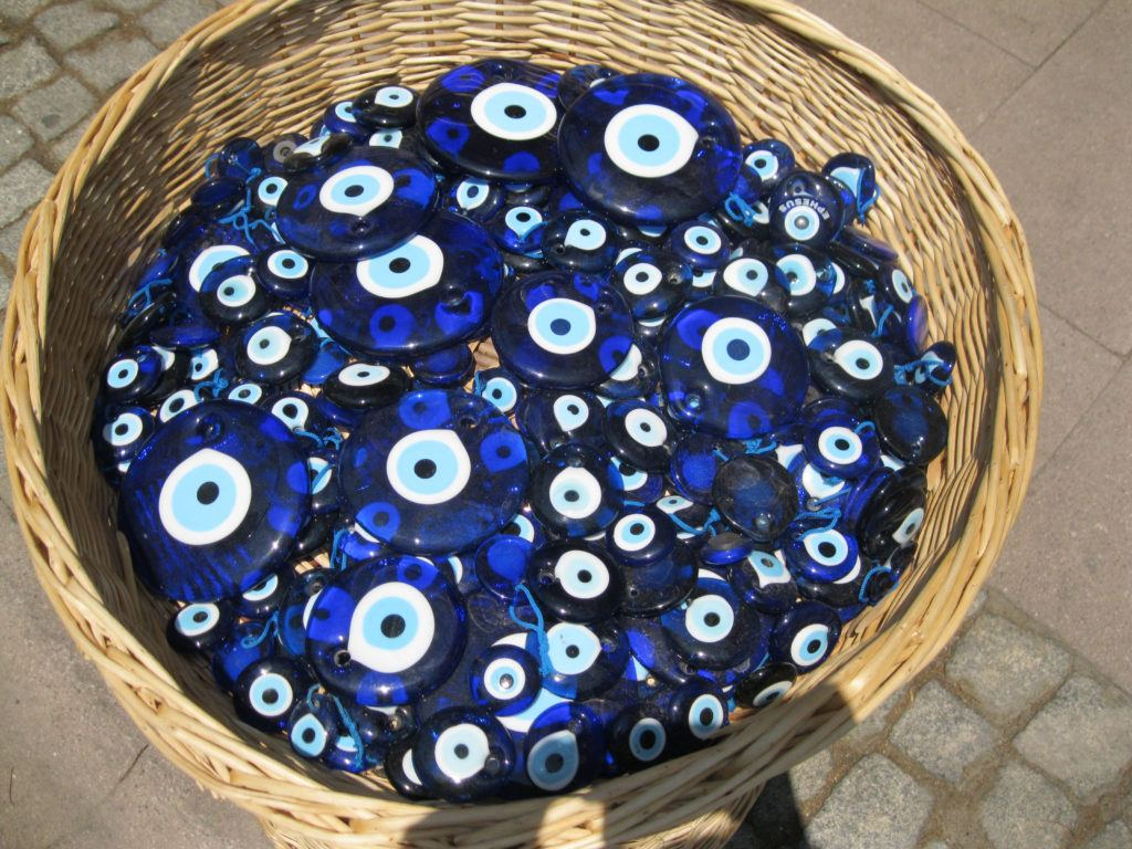 A basket of evil eye charms, which in Turkey, are called Nazar Boncuk meaning eye bead.