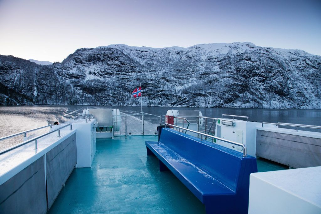 A boat on a fjords tour has the best views in Norway in winter.