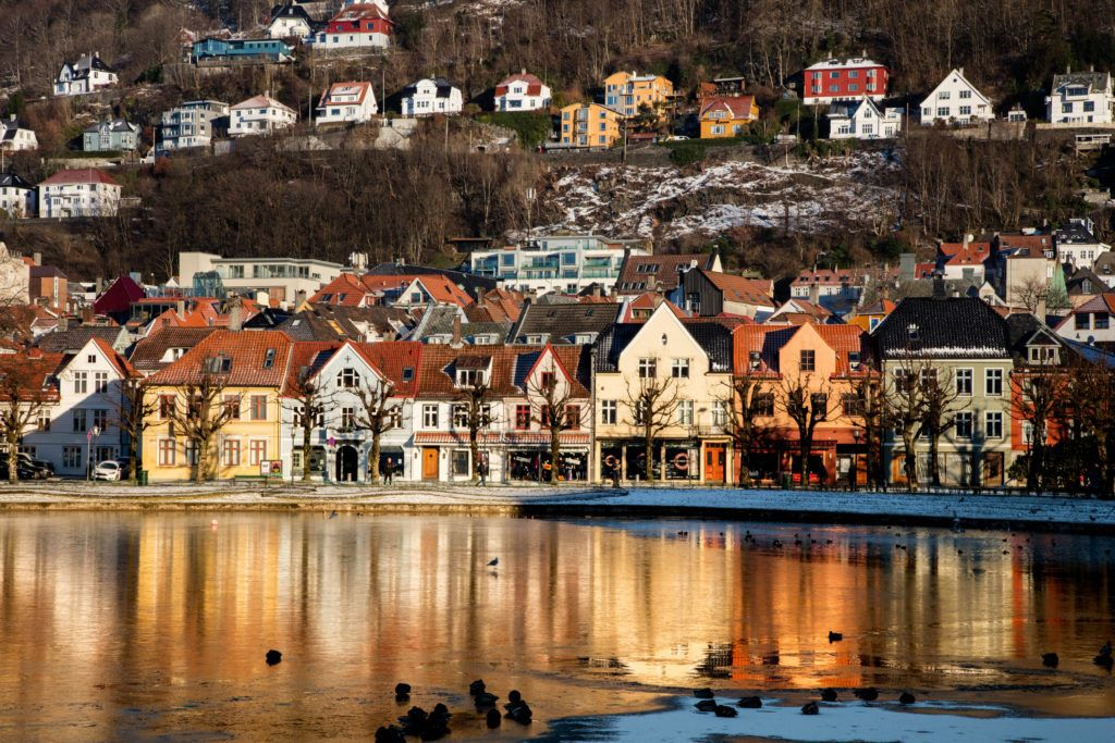 A lake glazed over with ice on a mid-winter's afternoon in Bergen, Norway.
