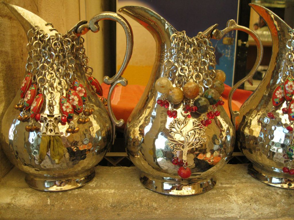 Beautiful polished and elaborately decorated copper water pitcher are perfect gifts from Turkey.