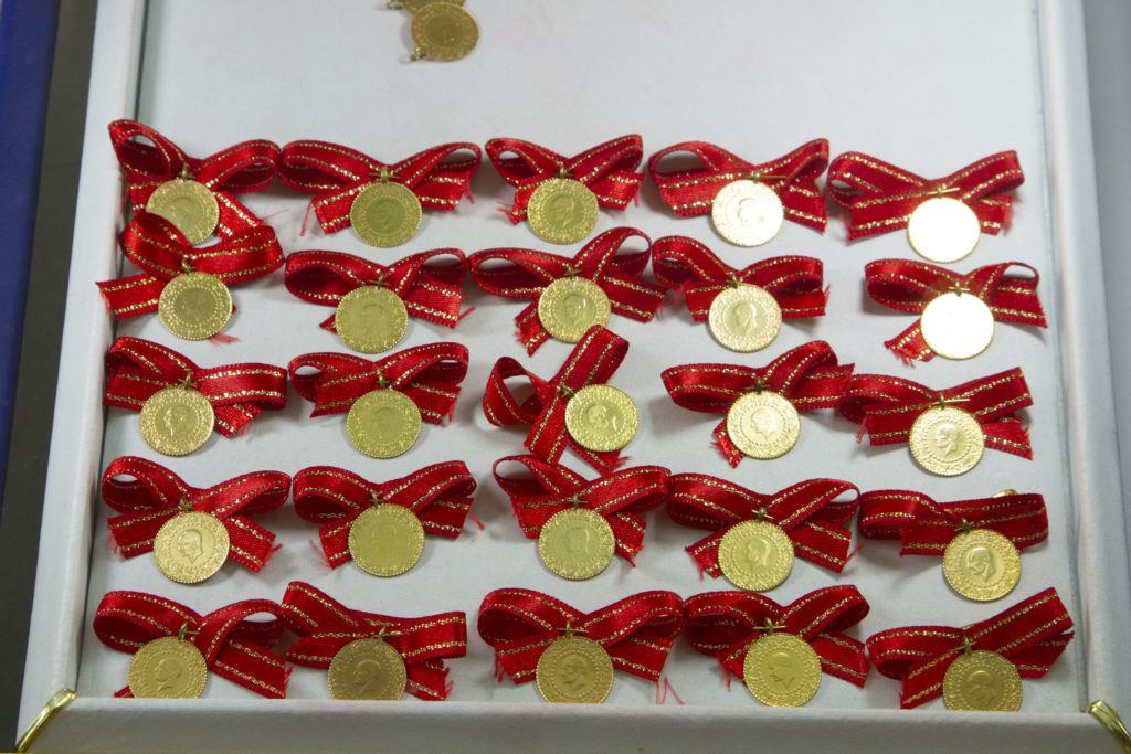 Gold coins attached to red ribbon bows are Turkish good luck objects and make great gifts from Turkey.