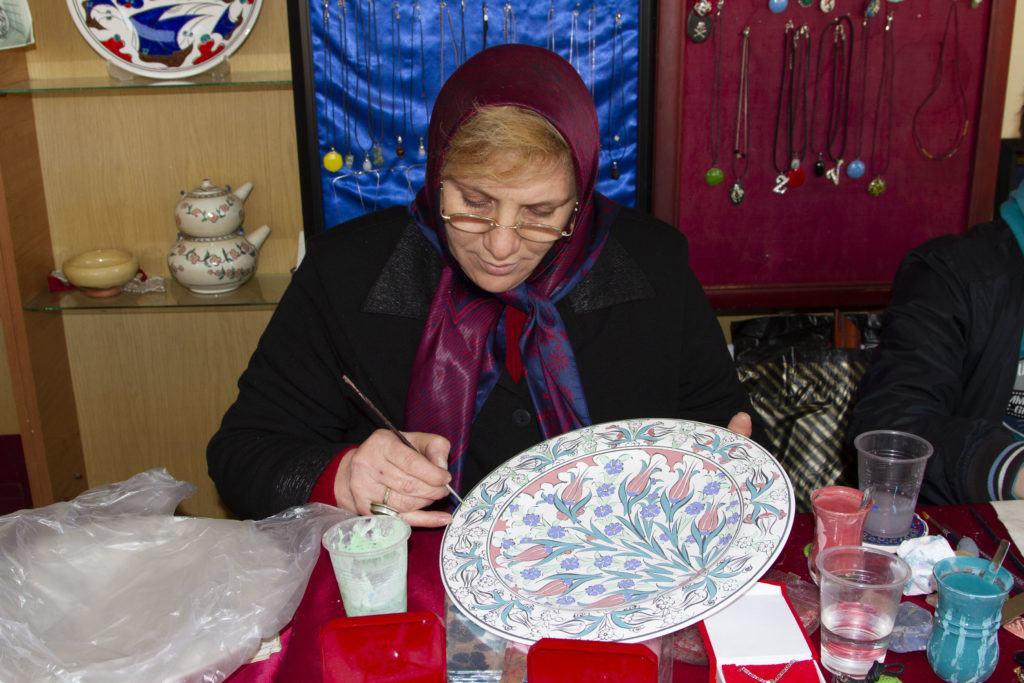 Women painting Iznik ceramics in Turkey.