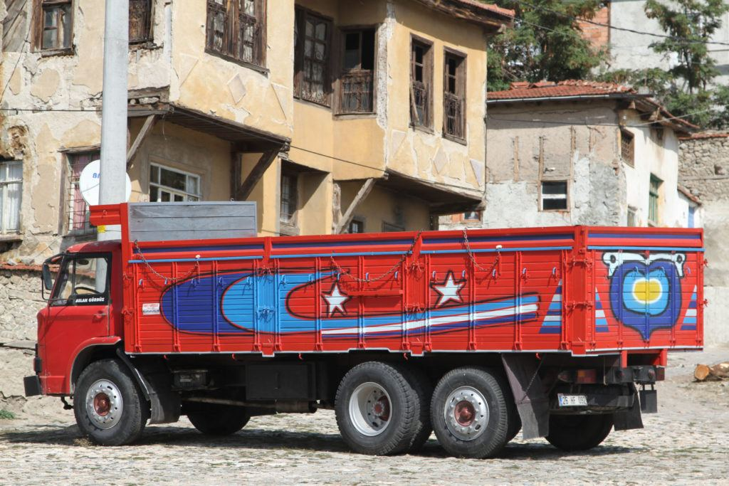Red truck in Turkey painted with evil eye art.