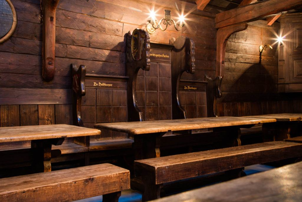 Wooden tables and benches at the Hanseatic Museum in Bergen, where meetings were once held.