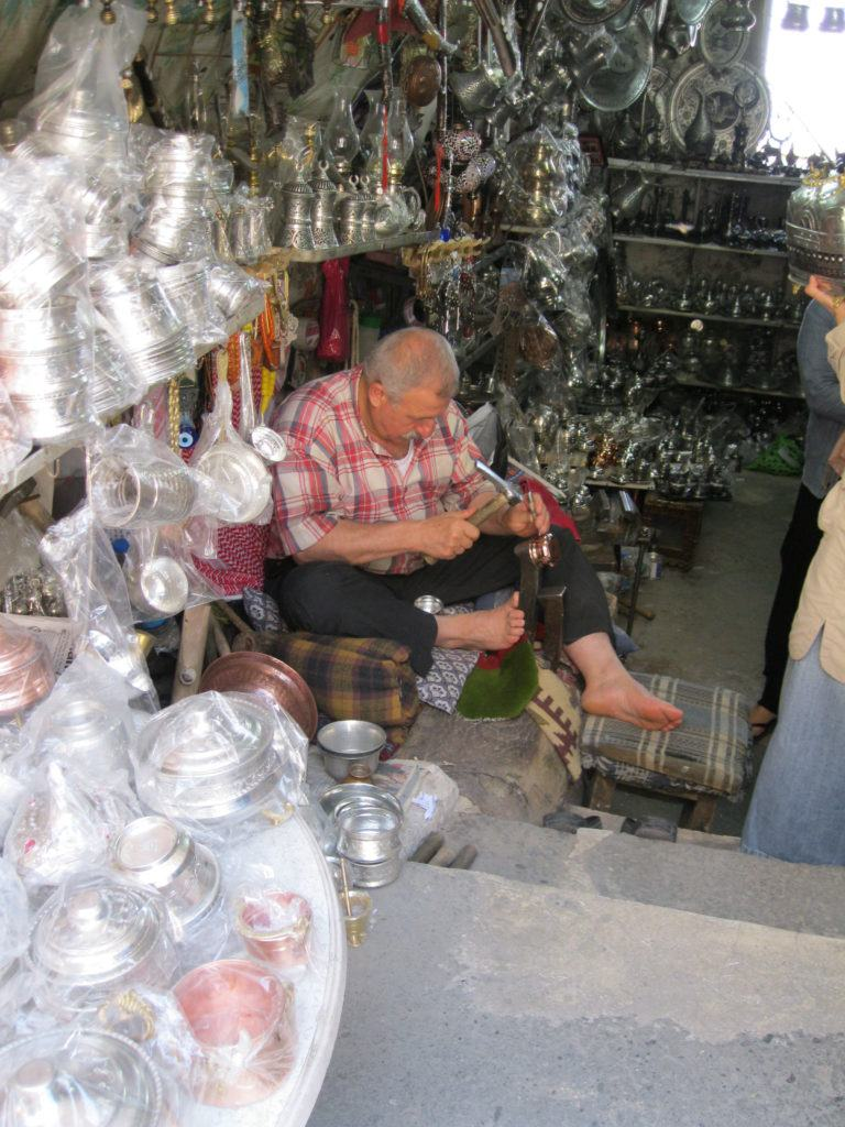 A copper artisan works in his shop in Gaziantep.
