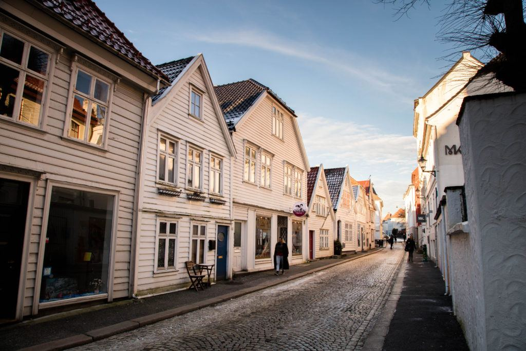 Street in Bergen with traditional white houses and dusting of snow. It's cold in Bergen in January, but it's also beautiful.